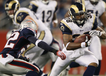 FOXBORO, MA - AUGUST 26:  Keith Toston #38 of the St. Louis Rams carries the ball as Terrence Wheatley #22 of the New England Patriots defends on August 26, 2010 at Gillette Stadium in Foxboro, Massachusetts. The Rams defeated the Patriots 36-35.  (Photo