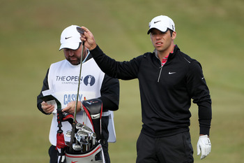 SANDWICH, ENGLAND - JULY 17:  Paul Casey of England selects a club prior to playing his second shot on the first hole uring the final round of The 140th Open Championship at Royal St George's on July 17, 2011 in Sandwich, England.  (Photo by Andrew Reding