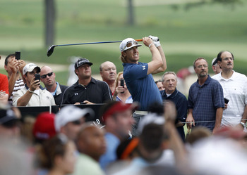 AKRON, OH - AUGUST 03:  Hunter Mahan watches his tee shot on the 11th hole during a practice round for the World Golf Championships Bridgestone Invitational at Firestone Country Club on August 3, 2011 in Akron, Ohio.  (Photo by Matt Sullivan/Getty Images)