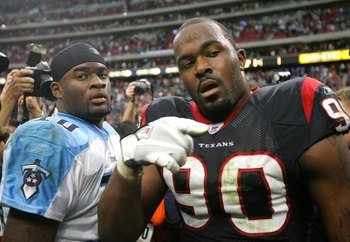 HOUSTON - DECEMBER 10:   Quarterback Vince Young #10 of the Tennessee Titans greets defensive lineman Mario Williams #90 of the Houston Texans after the game on December 10, 2006 at Reliant Stadium in Houston, Texas.  The Titans won 26-20 in overtime. (Ph