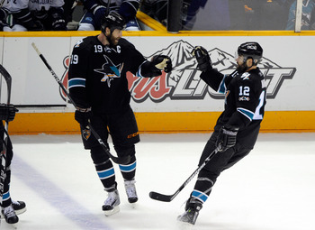 SAN JOSE, CA - MAY 20:  Joe Thornton #19 and Patrick Marleau #12 of the San Jose Sharks celebrate Marleau's second goal of the first period in Game Three of the Western Conference Finals during the 2011 Stanley Cup Playoffs at HP Pavilion on May 20, 2011