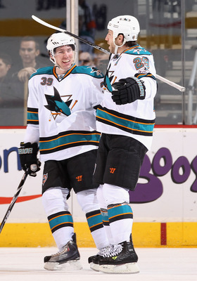GLENDALE, AZ - MARCH 26:  Ryane Clowe #29 of the San Jose Sharks celebrates with teammate Logan Couture #39 after Clowe scored a second period goal agianst the Phoenix Coyotes during the NHL game at Jobing.com Arena on March 26, 2011 in Glendale, Arizona.