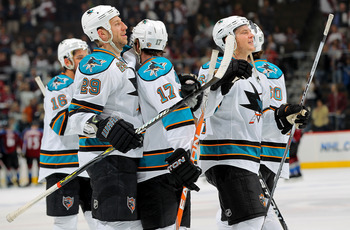 DENVER - APRIL 24:  Ryane Clowe #29, Torrey Mitchell #17 and Jamie McGinn #64 and the San Jose Sharks celebrate their victory over the Colorado Avalanche during Game Six of the Western Conference Quaterfinals of the 2010 Stanley Cup Playoffs at the Pepsi