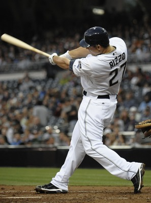 SAN DIEGO, CA - JUNE 28:  Anthony Rizzo #27 of the San Diego Padres hits a double during the fourth inning of a baseball game against the Kansas City Royals at Petco Park on June 28, 2011 in San Diego, California.  The Padres won 4-2. (Photo by Denis Poro