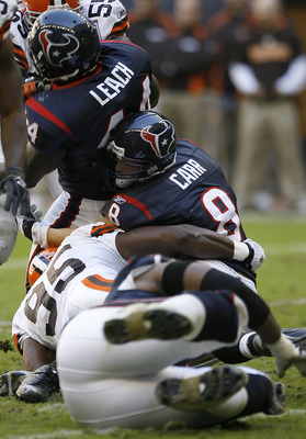 Houston Texans quarterback David Carr (8) gets wrapped up by Cleveland Browns linebacker Kamerion Wimbley (95).The Houston Texans defeated the Cleveland Browns 14-6 , Dec. 31, 2006 at Reliant Stadium in Houston, Texas. (Photo by Bob Levey/NFLPhotoLibrary)