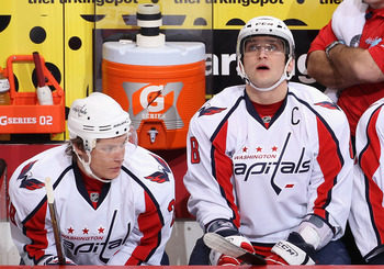 GLENDALE, AZ - FEBRUARY 14:  (L-R) Alexander Semin #28 and Alex Ovechkin #8 of the Washington Capitals on the bench during the NHL game against the Phoenix Coyotes at Jobing.com Arena on February 14, 2011 in Glendale, Arizona. The Coyotes defeated the Cap