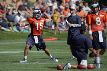 ENGLEWOOD, CO - JULY 28:  (L-R) Tim Tebow #15 and quarterback Kyle Orton #8 of the Denver Broncos take part in training camp at the Paul D. Bowlen Memorial Broncos Centre at Dove Valley on July 28, 2011 in Englewood, Colorado.  (Photo by Doug Pensinger/Ge