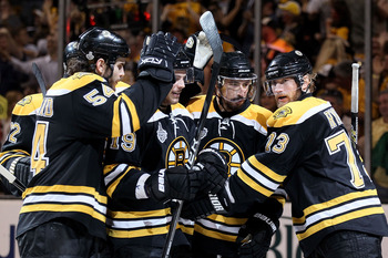 BOSTON, MA - JUNE 08:  Michael Ryder #73 of the Boston Bruins celebrates with his teammates Chris Kelly #23, Tyler Seguin #19 and Adam McQuaid #54 after scoring a goal in the second period against Roberto Luongo #1 of the Vancouver Canucks during Game Fou