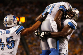 PITTSBURGH - AUGUST 14:  Calvin Johnson #81 of the Detroit Lions celebrates with teammates Jerome Felton #45 and Gosder Cherilus #77 during the preseason game against the Pittsburgh Steelers on August 14, 2010 at Heinz Field in Pittsburgh, Pennsylvania.