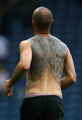 BLACKBURN, ENGLAND - AUGUST 15:  Detail showing the tattoo of Stephen Ireland of Manchester City at the end of the Barclays Premier League match between Blackburn Rovers and Manchester City at Ewood Park on August 15, 2009 in Blackburn, England.  (Photo b