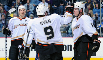NASHVILLE, TN - MARCH 24:  Bobby Ryan #9 and Ryan Getzlaf #15 of the Anaheim Ducks congratulate teammate Corey Perry #10 after scoring a goal against the Nashville Predators on March 24, 2011 at the Bridgestone Arena in Nashville, Tennessee.  (Photo by Fr