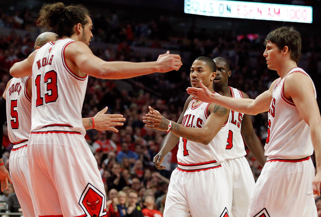 CHICAGO, IL - MAY 15:  (L-R) Carlos Boozer #5, Joakim Noah #13, Derrick Rose #1, Luol Deng #9 and Kyle Korver #23 of the Chicago Bulls huddle up in the first half against the Miami Heat in Game One of the Eastern Conference Finals during the 2011 NBA Play