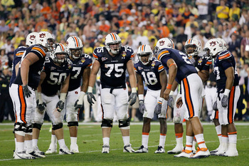 GLENDALE, AZ - JANUARY 10:  The Auburn Tigers huddle against the Oregon Ducks during the Tostitos BCS National Championship Game at University of Phoenix Stadium on January 10, 2011 in Glendale, Arizona.  (Photo by Kevin C. Cox/Getty Images)