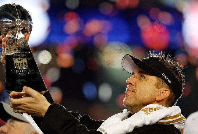 MIAMI GARDENS, FL - FEBRUARY 07:  Head coach Sean Payton of the New Orleans Saints celebrates with the Vince Lombardi Trophy after his team defeated the Indianapolis Colts during Super Bowl XLIV on February 7, 2010 at Sun Life Stadium in Miami Gardens, Fl