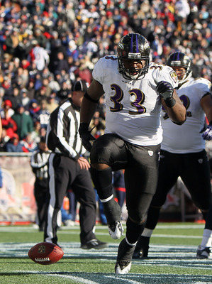 FOXBORO, MA - JANUARY 10:  Le'Ron McClain #33 of the Baltimore Ravens celebrates after he scored a 1-yard touchdown run in the first quarter against the New England Patriots during the 2010 AFC wild-card playoff game at Gillette Stadium on January 10, 201