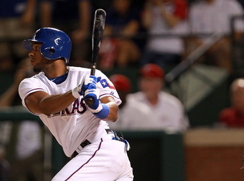 ARLINGTON, TX - AUGUST 07:  Elvis Andrus #1 of the Texas Rangers hits a single for a two run RBI against the Cleveland Indians at Rangers Ballpark in Arlington on August 7, 2011 in Arlington, Texas.  (Photo by Ronald Martinez/Getty Images)