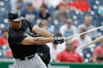 WASHINGTON, DC - JULY 28: Mike Stanton #27 of the Florida Marlins breaks his bat against the Washington Nationals at Nationals Park on July 28, 2011 in Washington, DC. (Photo by Rob Carr/Getty Images)