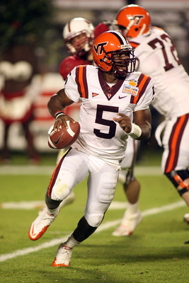 MIAMI, FL - JANUARY 03:  Tyrod Taylor #5 of the Virginia Tech Hokies rolls out of the pocket against the Stanford Cardinal during the 2011 Discover Orange Bowl at Sun Life Stadium on January 3, 2011 in Miami, Florida. Stanford won 40-12. (Photo by Marc Se