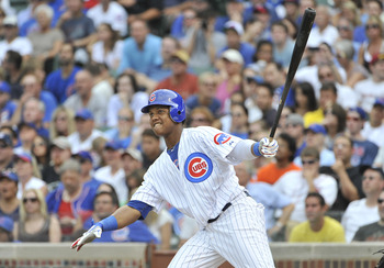 CHICAGO, IL - AUGUST 06: Starlin Castro #13 of the Chicago Cubs follows through on an RBI double scoring Reed Johnson and Alfonso Soriano during the fifth inning against the Cincinnati Reds at Wrigley Field on August 6, 2011 in Chicago, Illinois.  (Photo