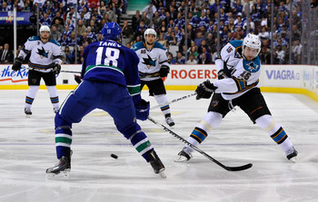 VANCOUVER, CANADA - MAY 24:  Dany Heatley #15 of the San Jose Sharks shoots the puck from the left wing as Chris Tanev #18 of the Vancouver Canucks defends the play in Game Five of the Western Conference Finals during the 2011 Stanley Cup Playoffs at Roge