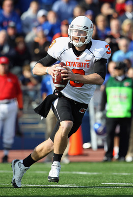 LAWRENCE, KS - NOVEMBER 20:  Quarterback Brandon Weeden #3 of the Oklahoma State Cowboys in action during the game against  the Kansas Jayhawks on November 20, 2010 at Memorial Stadium in Lawrence, Kansas.  (Photo by Jamie Squire/Getty Images)