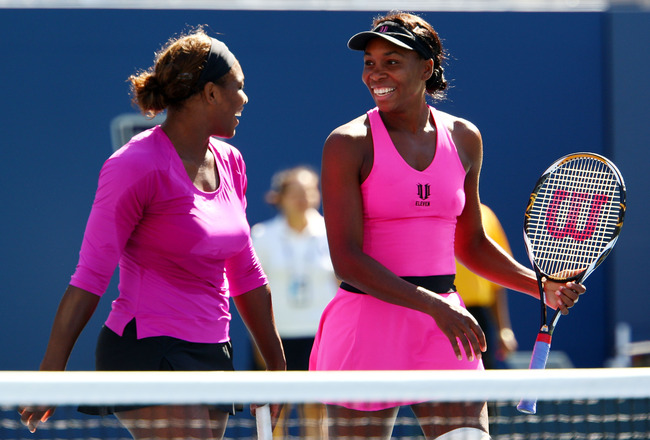 NEW YORK - SEPTEMBER 14:  Venus Williams (R) and Serena Williams celebrate after defeating Cara Black of Zimbabwe and Liezel Huber in the Women's Doubles final on day fifteen of the 2009 U.S. Open at the USTA Billie Jean King National Tennis Center on Sep