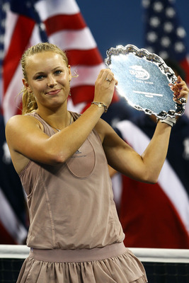 NEW YORK - SEPTEMBER 13:  Caroline Wozniacki of Denmark poses with her runner up trophy after the Women�s Singles final against Kim Clijsters of Belgium on day fourteen of the 2009 U.S. Open at the USTA Billie Jean King National Tennis Center on September
