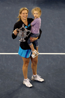 NEW YORK - SEPTEMBER 11:  Kim Clijsters of Belgium and daughter Jada pose with the championship trophy after Clijsters defeated Vera Zvonareva of Russia during their women's singles final on day thirteen of the 2010 U.S. Open at the USTA Billie Jean King