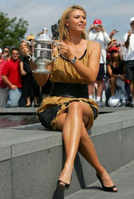 NEW YORK - SEPTEMBER 10:  Maria Sharapova pose for photographers with the women's championship trophy outside of Arthur Ashe Stadium after winning the U.S. Open at the USTA Billie Jean King National Tennis Center in Flushing Meadows Corona Park on Septemb