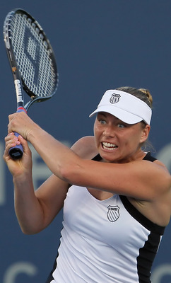 CARLSBAD, CA - AUGUST 02:  Vera Zvonareva of Russia follows through on a backhand return to Jill Craybas during the Mercury Insurance Open presented by Tri-City Medical at the La Costa Resort and Spa on August 2, 2011 in Carlsbad, California.  (Photo by J