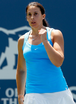 STANFORD, CA - JULY 31:  Marion Bartoli of France celebrates a point against Serena Williams during the final of the Bank of the West Classic at the Taube Family Tennis Stadium on July 31, 2011 in Stanford, California.  (Photo by Matthew Stockman/Getty Im