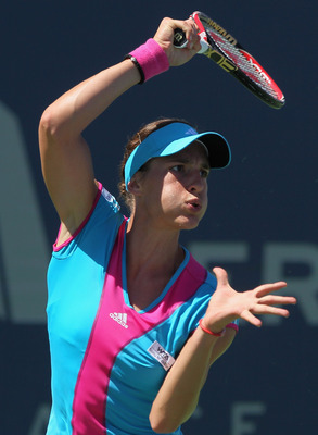 CARLSBAD, CA - AUGUST 06:  Andrea Petkovic of Germany follows through on a forehand to Agnieszka Radwanska of Poland during the Mercury Insurance Open presented by Tri-City Medical at the La Costa Resort and Spa on August 6, 2011 in Carlsbad, California.