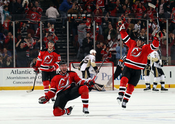 NEWARK, NJ - MARCH 04:  Ilya Kovalchuk #17 of the New Jersey Devils celebrates his game winning goal at 4:35 of overtime against the Pittsburgh Penguins at  at the Prudential Center on March 4, 2011 in Newark, New Jersey.  (Photo by Bruce Bennett/Getty Im