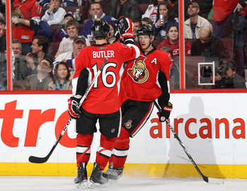OTTAWA, CANADA - APRIL 2: Jason Spezza #19 of the Ottawa Senators celebrates his first goal of the game with team mate Bobby Butler #16 in a game against the Toronto Maple Leafs at Scotiabank Place on April 2, 2011 in Ottawa, Ontario, Canada.  (Photo by J
