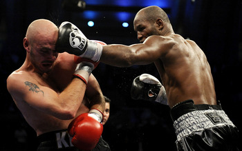 ATLANTIC CITY, NJ - OCTOBER 18:  Bernard Hopkins of Philadelphia,  Pennsylvania (R) connects with a jab to Kelly Pavlik of Youngstown, Ohio during their light heavyweight bout at Boardwalk Hall on October 18, 2008 in Atlantic City, New Jersey.  (Photo by