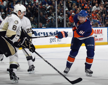 UNIONDALE, NY - APRIL 08: John Tavares #91 of the New York Islanders skates against the Pittsburgh Penguins at the Nassau Coliseum on April 8, 2011 in Uniondale, New York.  (Photo by Bruce Bennett/Getty Images)