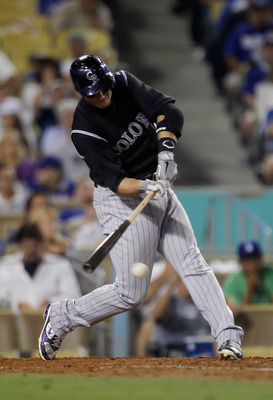 LOS ANGELES, CA - JULY 27:  Troy Tulowitzki #2 of the Colorado Rockies hits an RBI single against the Los Angeles Dodgers in the fifth inning at Dodger Stadium on July 27, 2011 in Los Angeles, California.  (Photo by Jeff Gross/Getty Images)