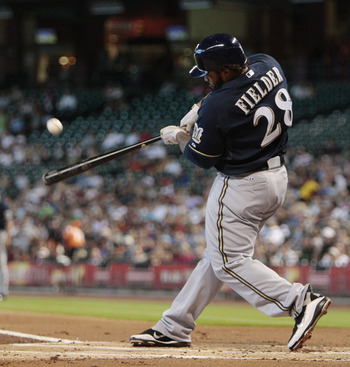 HOUSTON - AUGUST 07: Prince Fielder #28 of the Milwaukee Brewers hits a two run home run to left field in the first inning off pitcher Bud Norris of the Houston Astros at Minute Maid Park on August 7, 2011 in Houston, Texas. (Photo by Bob Levey/Getty Imag