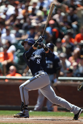 SAN FRANCISCO, CA - JULY 24:  Ryan Braun #8 of the Milwaukee Brewers hits a home run in the first inning against the San Francisco Giants at AT&T Park on July 24, 2011 in San Francisco, California.  (Photo by Jed Jacobsohn/Getty Images)