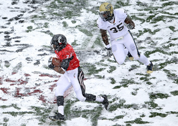 CINCINNATI, OH - DECEMBER 04:  Isaiah Pead #23 of the Cincinnati Bearcats runs with the ball  during the Big East Conference game against the Pittsburgh Panthers at Nippert Stadium on December 4, 2010 in Cincinnati, Ohio. Pittsburgh won 28-10.  (Photo by