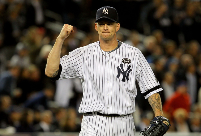 NEW YORK - OCTOBER 19:  A.J. Burnett #34 of the New York Yankees reacts against the Texas Rangers in Game Four of the ALCS during the 2010 MLB Playoffs at Yankee Stadium on October 19, 2010 in the Bronx borough of New York City.  (Photo by Jim McIsaac/Get