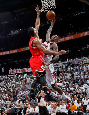 ATLANTA, GA - MAY 12:  Derrick Rose #1 of the Chicago Bulls defends a dunk by Jamal Crawford #11 of the Atlanta Hawks in Game Six of the Eastern Conference Semifinals in the 2011 NBA Playoffs at Phillips Arena on May 12, 2011 in Atlanta, Georgia.  NOTE TO