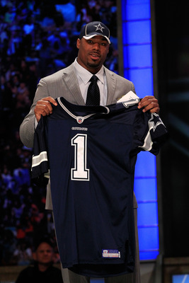 NEW YORK, NY - APRIL 28:  Tyron Smith, #9 overall pick by the Dallas Cowboys, holds up a jersey on stage during the 2011 NFL Draft at Radio City Music Hall on April 28, 2011 in New York City.  (Photo by Chris Trotman/Getty Images)