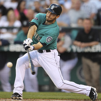 SEATTLE - AUGUST 01:  Dustin Ackley #13 of the Seattle Mariners hits a three-run RBI triple in the second inning against the Oakland Athletics at Safeco Field on August 1, 2011 in Seattle, Washington. (Photo by Otto Greule Jr/Getty Images)