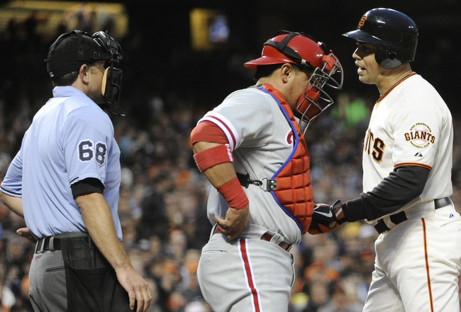 SAN FRANCISCO, CA - AUGUST 4: Carlos Beltran #15 of the San Francisco Giants lets home plate umpire Chris Guccione #68 know that he doesn't like the call strike three in the fourth inning during an MLB baseball game at AT&T Park August 4, 2011 in San Fran