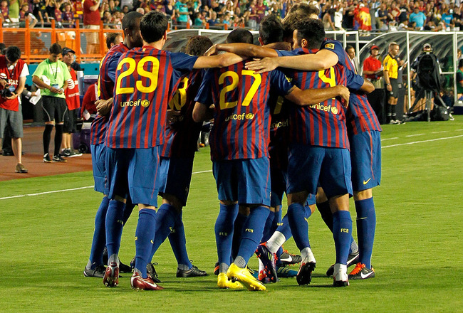 MIAMI GARDENS, FL - AUGUST 03: FC Barcelona celebrates after a goal during a game against CD Guadalajara during the 2011 World Football Challenge at Sun Life Stadium on August 3, 2011 in Miami Gardens, Florida.  (Photo by Mike Ehrmann/Getty Images)