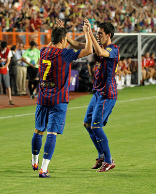 MIAMI GARDENS, FL - AUGUST 03: David Villa #7 of FC Barcelona is congratulated by Cuenca #29 after scoring a goal during a game against CD Guadalajara during the 2011 World Football Challenge at Sun Life Stadium on August 3, 2011 in Miami Gardens, Florida