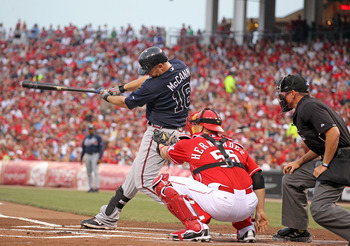 CINCINNATI, OH - JULY 24:  Brian McCann #16 of the Atlanta Braves  swings at a pitch during the game against the Cincinnati Reds at Great American Ball Park at Great American Ball Park on July 24, 2011 in Cincinnati, Ohio.  (Photo by Andy Lyons/Getty Imag