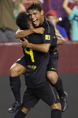 LANDOVER, MD - JULY 30: Thiago Alcantara #4 of  Barcelona celebrates his second half goal with teammate Jonathan dos Santos (R) against Manchester United during a friendly match at FedExField on July 30, 2011 in Landover, Maryland.  (Photo by Rob Carr/Get