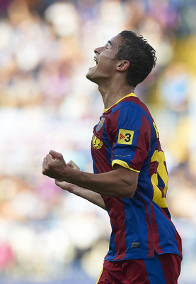 MALAGA, SPAIN - MAY 21: Ibrahim Afellay of Barcelona celebrates after scoring during the La Liga match between Malaga and Barcelona at La Rosaleda Stadium on May 21, 2011 in Malaga, Spain. (Photo by Manuel Queimadelos Alonso/Getty Images)
